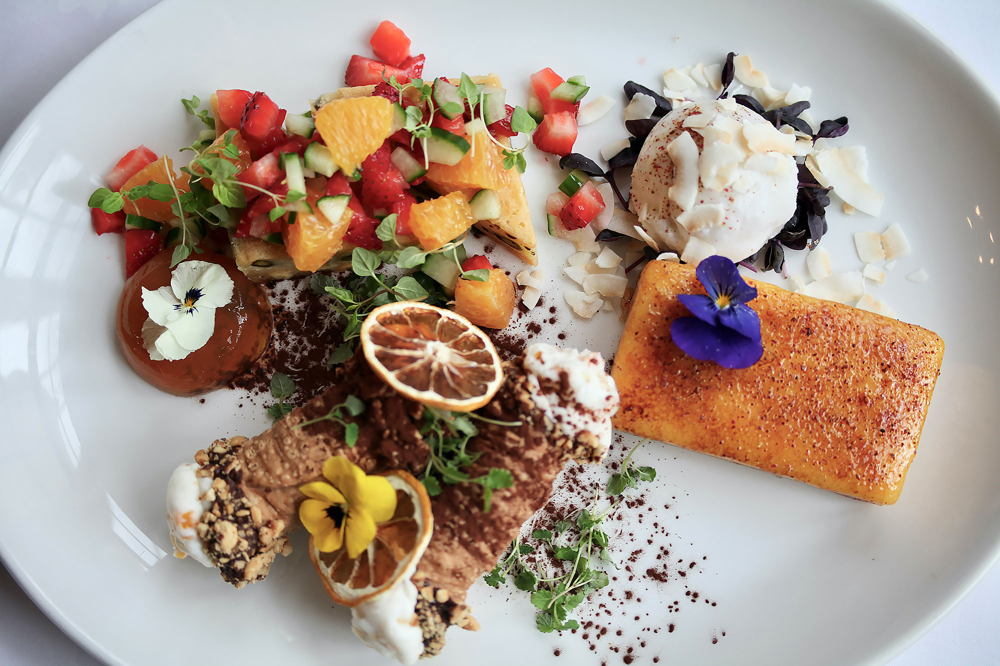 To finish: A sharing platter of course! 1. Sicilian cannoli, ricotta, gianduja, candied lemon 2. White chocolate and pistachio brownie, Pimm's jelly strawberries, cucumber, orange, mint 3. Caramelized passion fruit tart, coconut sorbet, pink peppercorn, basil.
